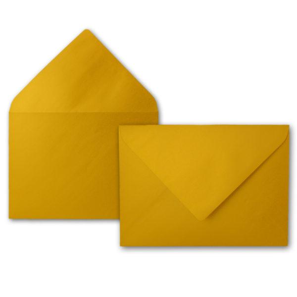 Umschlag B6, Farbe: gold, Grammatur: 90 g/m², spitze Klappe, Naßklebung