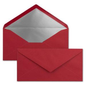 Briefumschlag DL, Farbe: weihnachtsrot, Grammatur: 120 g/m², spitze Klappe, Naßklebung, Seidenfutter: silber