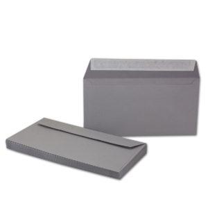 Umschlag DL, Farbe dunkelgrau, mit Haftklebung, Grammatur: 110 g/m²