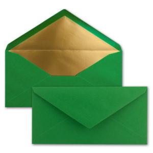 Briefumschlag DL, Farbe: tannengrün, Grammatur: 120 g/m², spitze Klappe, Naßklebung, Seidenfutter: gold