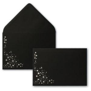 Umschlag B6, Farbe: schwarz mit Foliensternen silber, Grammatur: 120 g/m², spitze Klappe, Nassklebung