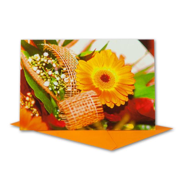 Glückwunschkarte, orange Gerbera mit Schleife